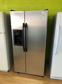 "Stainless Steel/Black GE 33"" Side by Side Refrigerator  47 km"