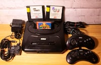 Sega Genesis console with 2 controllers 3 games  Vancouver, V5S 4X4