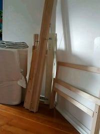 Twin ikea wooden bed frame with white mattress Vancouver, V5X