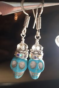 Turquoise color skull and crystal crown earrings