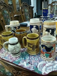 Variety of 8 ceramic beer steins