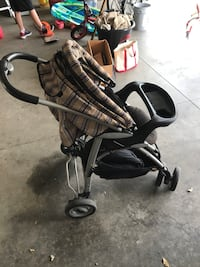 Baby's brown and black stroller Brooklyn Park, 55443
