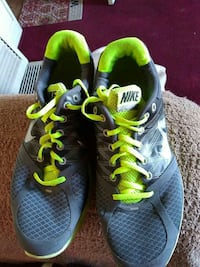pair of black Nike running shoes