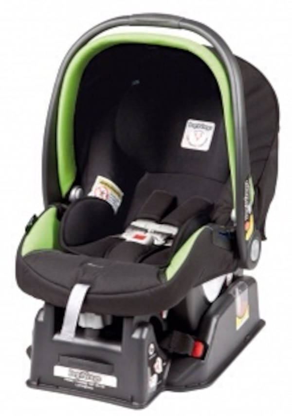 black and green child safety seat and black base