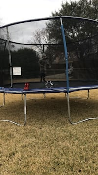 Blue and black trampoline with enclosure Rowlett