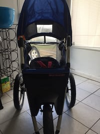 baby's black and blue Schwinn jogging stroller Woodbridge, 22191