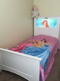 White wooden bed frame with pink princess comforter Gainesville, 20155