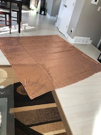 Large rose gold table cloth.