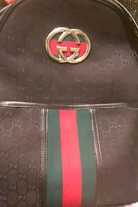 black and green Gucci leather bag