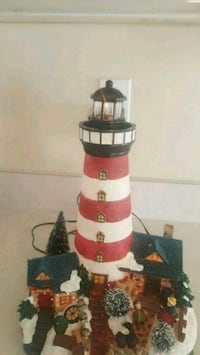 red and black ceramic light house Shady Side