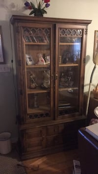 Brown wooden framed glass display cabinet Valley Stream, 11581