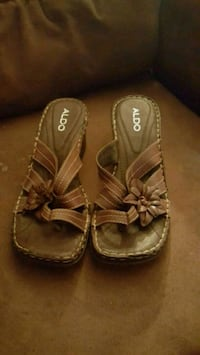 pair of brown leather sandals Calgary, T2B 0J2