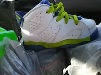 unpaired white blue and green basketball shoe