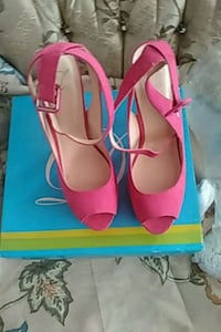 pair of pink leather open toe ankle strap heels Montréal, H1E 1W8