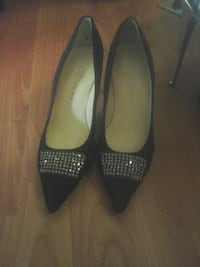 pair of black pointed stilettos with clear gemstones