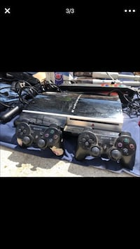 Black sony ps3 super slim console with controllers 14 games guns and guitar Bloomington, 92316
