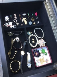 Assorted jewelry collection in box