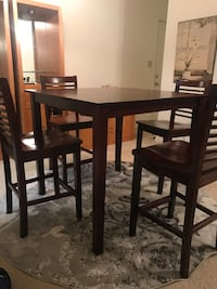 Counter height table. Solid wood. Some minor surface marks that can be easily repaired   High Point, 27265