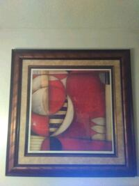 red and white abstract painting with black wooden frame Shelbyville, 37160