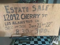brown wooden wall decor with text Los Alamitos, 90720