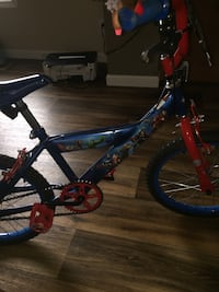 toddler's Marvel Avengers themed blue bicycle