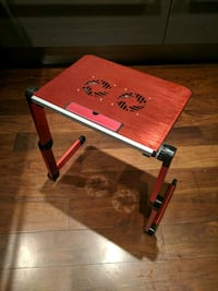 red and black metal folding table Vancouver, V6E 1A7