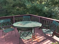 Round metal framed glass top patio table North Attleboro, 02760