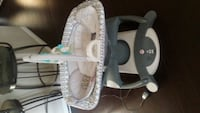 Baby swing  4 in 1 rock and glide soother multi. Calgary, T3J