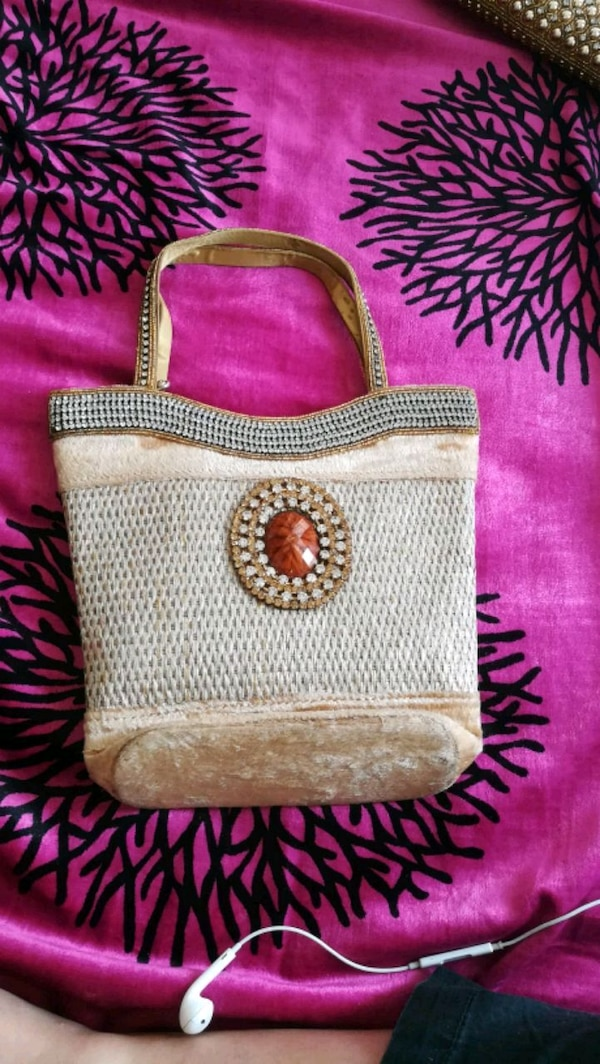 white and brown leather crossbody bag