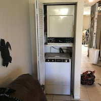 white and black wooden cabinet Ormond Beach, 32176