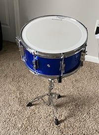 Ludwig Drum set with Echo canciling rings and music stand and Sticks