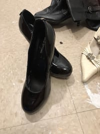 pair of black leather heeled shoes Longueuil, J4L 4C8
