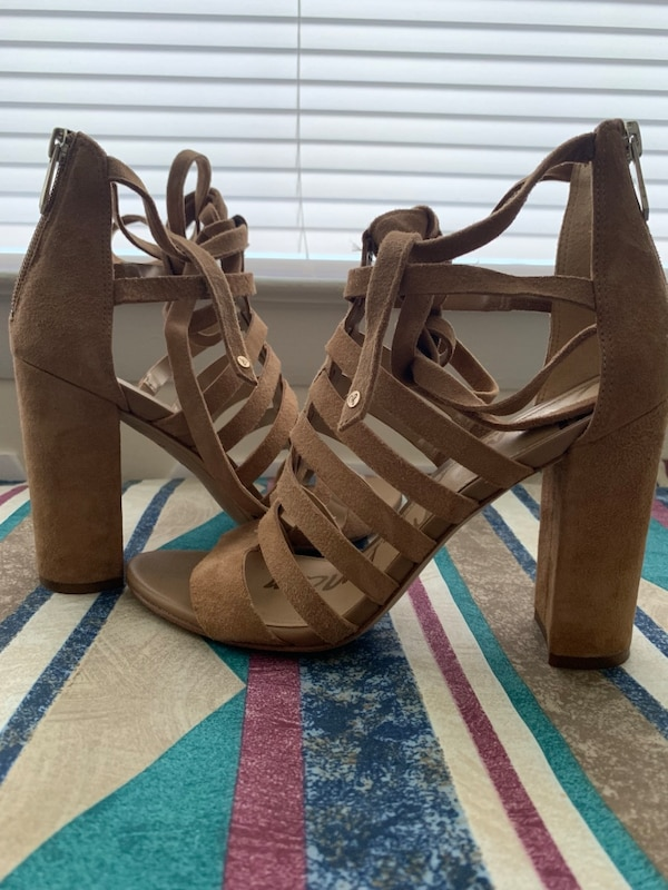 pair of brown leather open toe ankle strap heels bab904f2-78c9-43a7-b3ba-3dd10303be96