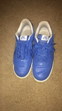 pair of blue Nike low-top sneakers Ranson, 25438