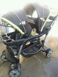 baby's black and green stroller 2181 mi