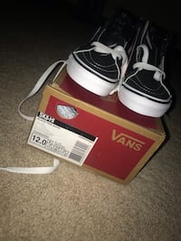 Pair of black vans low top sneakers on box