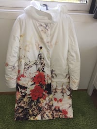 Beautiful white flower print white padded jacket.