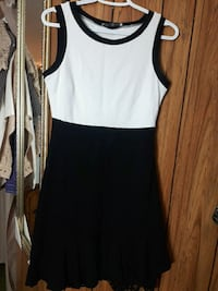 Black and white dress. Fit to Small or Miduiim.