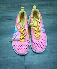 pair of pink Nike running shoes Pinole