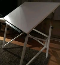 White wooden folding table with chair