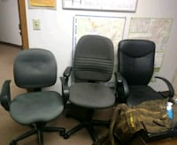 four black leather padded rolling chairs Colorado Springs, 80916