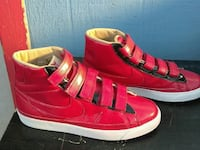 pair of red Nike patent leather velcro strap shoes