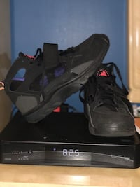 pair of black Nike Huarache shoes with box
