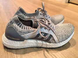 size7 women of gray-and-black Adidas running shoes