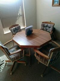 rectangular brown wooden table with four chairs dining set Tucson, 85756