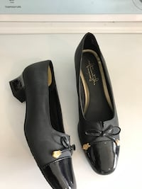 Women's black leather bow heels Clarksville, 37042