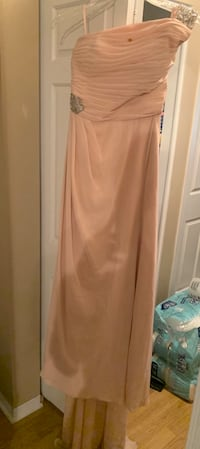 Evening gown with a small stain , comes with a train
