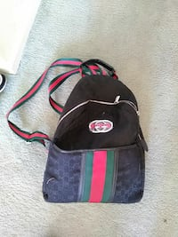monogrammed black, red, and green Gucci backpack