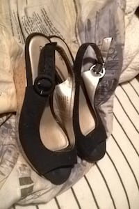 Pair of black suede open-toe slingback wedge shoes