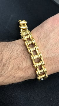 gold link bracelet with gold analog watch
